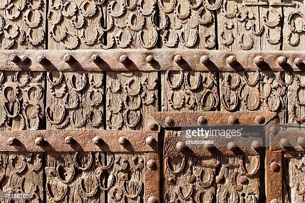 close-up of horse shoes on a wooden door, buland darwaza, fatehpur sikri, agra, uttar pradesh, india - fatehpur sikri stock pictures, royalty-free photos & images
