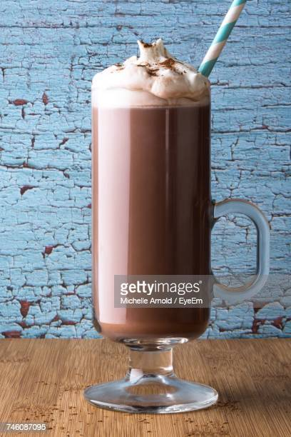 Close-Up Of Hot Chocolate Glass On Table