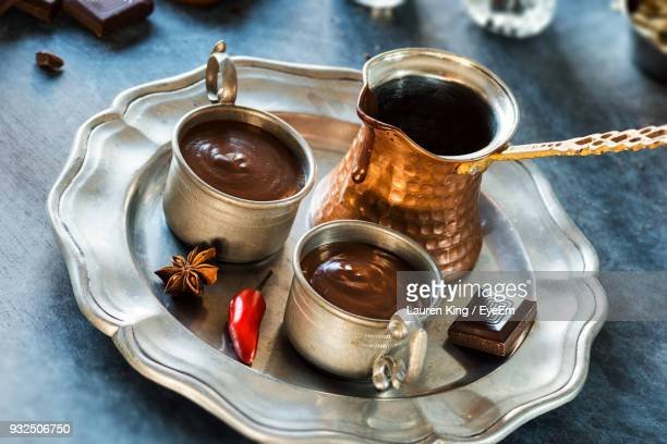 close-up of hot chocolate in cups on table - spesso foto e immagini stock