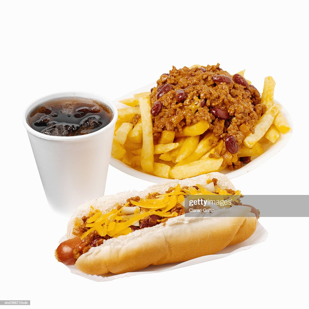 Close-up of hotdog and chili french-fries with cold drink : Stock Photo