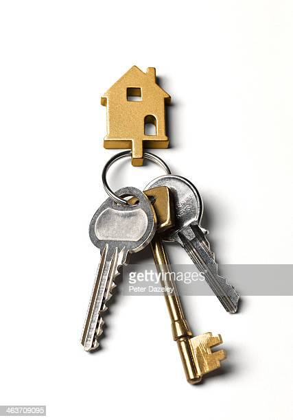 Close-up of house keys on white background