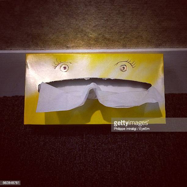Close-Up Of Human Eyes Drawn On Tissue Box