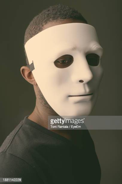 close-up of human face against black background - human face foto e immagini stock