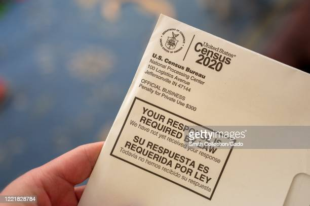 Closeup of human hand holding a letter from the Census Bureau regarding the 2020 Census San Ramon California April 24 2020