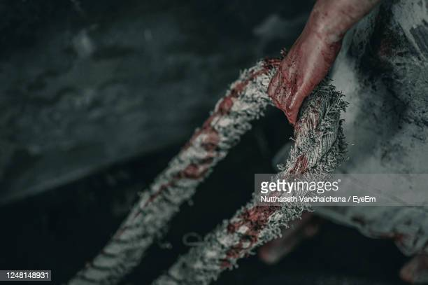 close-up of human hand holding rope - female torture stock pictures, royalty-free photos & images