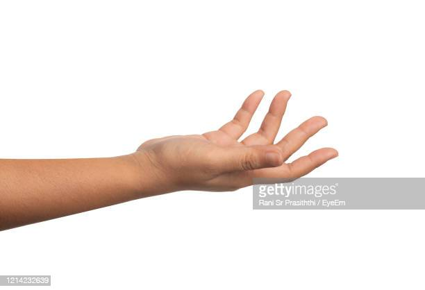 close-up of human hand over white background - geben stock-fotos und bilder