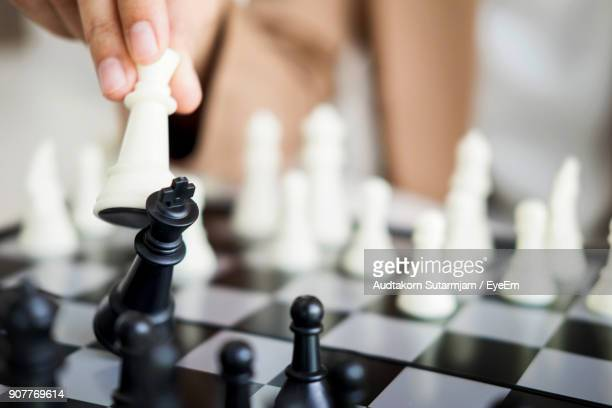 close-up of human hand playing chess - chess stock pictures, royalty-free photos & images