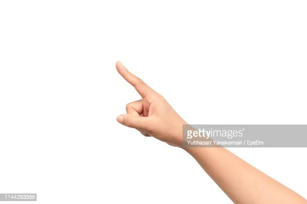 close-up of human hand pointing against white background - mostrar - fotografias e filmes do acervo