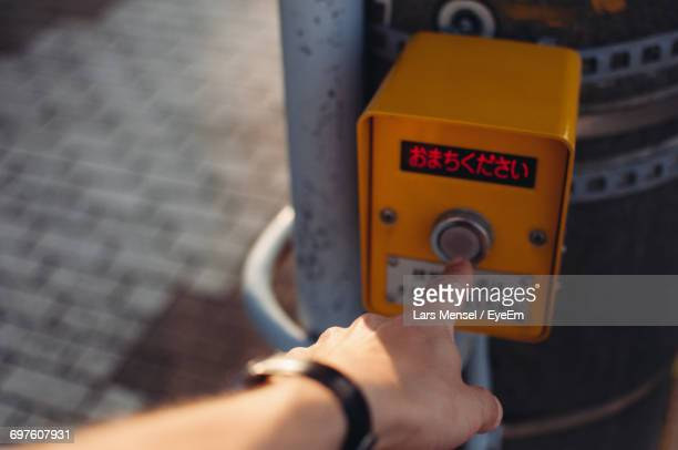 Close-Up Of Human Hand Pressing Button