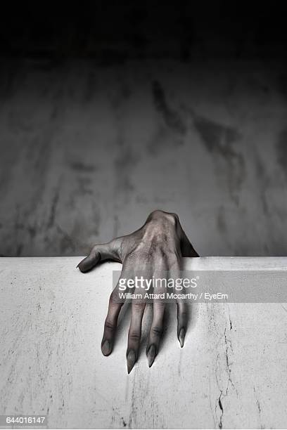 close-up of human hand touching wall - spooky stock pictures, royalty-free photos & images