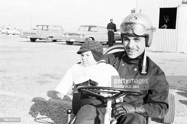 CloseUp Of Hussein Of Jordan Jordanie 21 mars 1963 le Roi HUSSEIN DE JORDANIE en famille Sur la piste de karting aux abords de l'aérodrome d'Amman il...