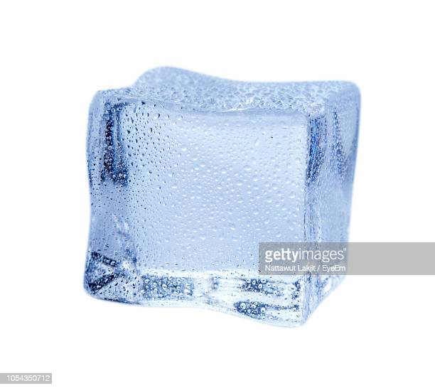 close-up of ice against white background - ice cube stock pictures, royalty-free photos & images