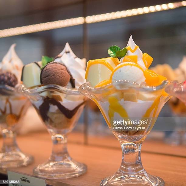 Close-Up Of Ice Cream Sundaes On Table