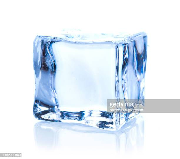 close-up of ice cube against white background - ice cube stock pictures, royalty-free photos & images