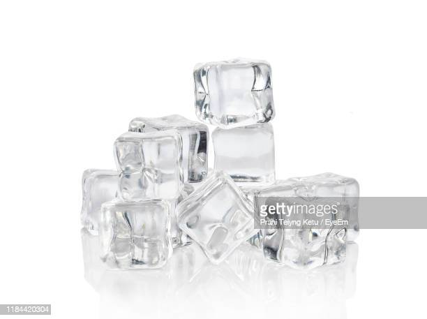 close-up of ice cubes against white background - ice cube stock pictures, royalty-free photos & images