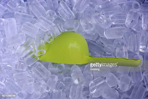 Closeup of icecubes and green plastic spoon Vientiane Laos