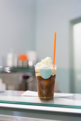 Close-up of iced coffee on counter at store - gettyimageskorea