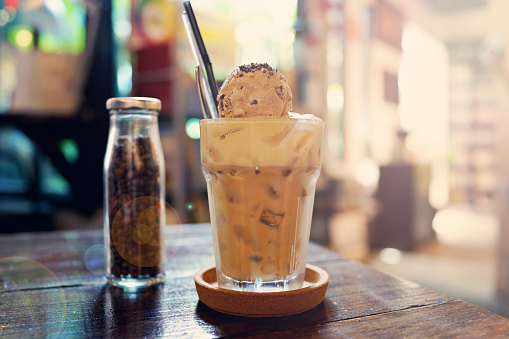 Close-Up Of Iced Coffee On Wooden Table - gettyimageskorea