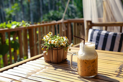 Close-Up Of Iced Coffee Served In Mason Jar On Table At Balcony - gettyimageskorea
