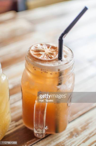a close-up of iced tea with lemon, passion fruit and chia seeds - capital region stock pictures, royalty-free photos & images