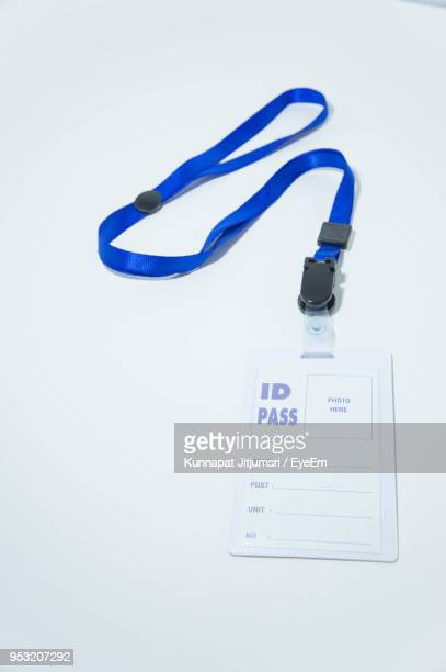 close-up of id card over white background - identity card stock pictures, royalty-free photos & images