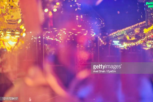 close-up of illuminated amusement park at night - carnival stock pictures, royalty-free photos & images