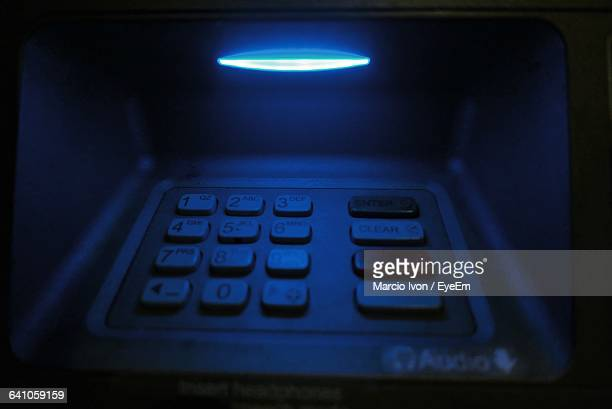 close-up of illuminated blue atm keypad - transfer image stock pictures, royalty-free photos & images