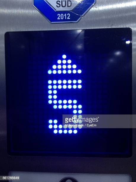 Close-Up Of Illuminated Blue Number 5 Button Of Elevator