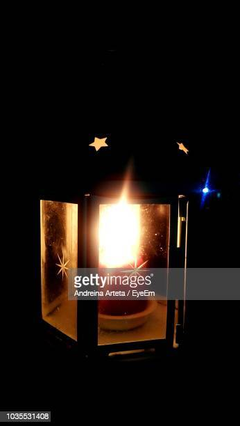 close-up of illuminated candle in lamp - arteta stock photos and pictures