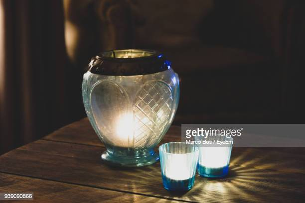 Close-Up Of Illuminated Candle On Table