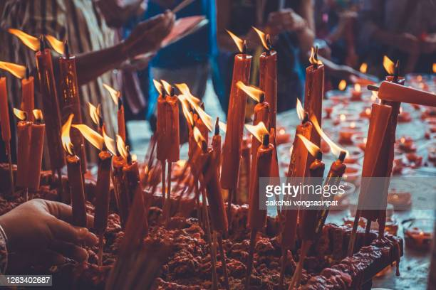close-up of illuminated candles in temple at yaowarat in bangkok, thailand, asia - 2020 2029 stock pictures, royalty-free photos & images
