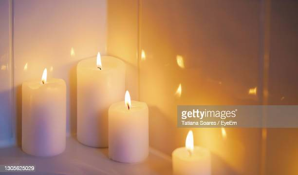 close-up of illuminated candles - lord bath stock pictures, royalty-free photos & images