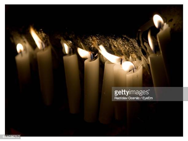 close-up of illuminated candles - transferbild stock-fotos und bilder