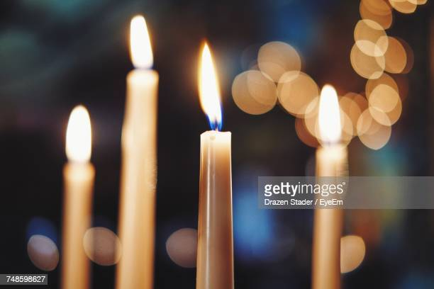 Close-Up Of Illuminated Candles