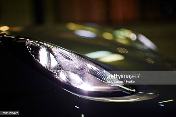Close-Up Of Illuminated Car Headlights