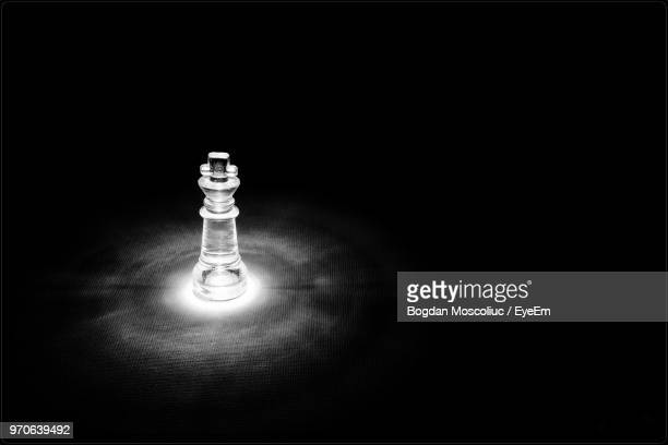 close-up of illuminated chess pieces - chess piece stock pictures, royalty-free photos & images