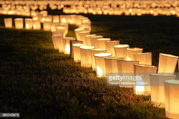 Close-Up Of Illuminated Chinese Lanterns On Grass