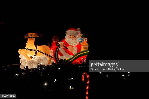 close-up of illuminated christmas decoration in darkroom - santa close up stock pictures, royalty-free photos & images