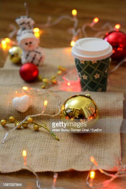 Close-Up Of Illuminated Christmas Decorations On Table