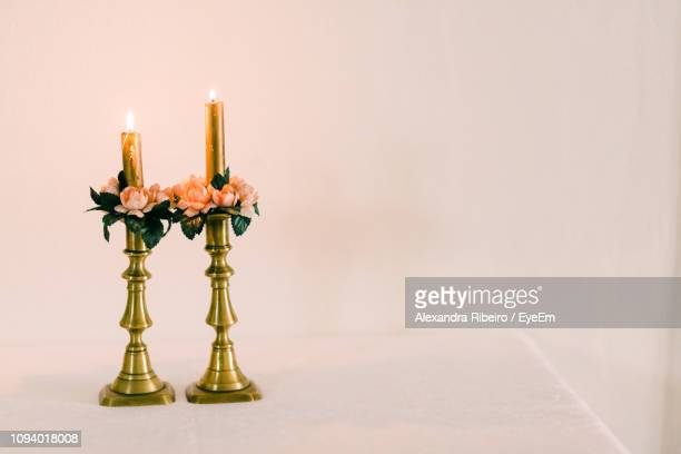 close-up of illuminated decoration against white background - candlestick holder stock pictures, royalty-free photos & images