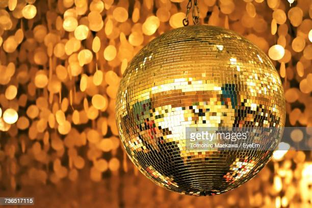 close-up of illuminated disco ball - disco ball stock photos and pictures