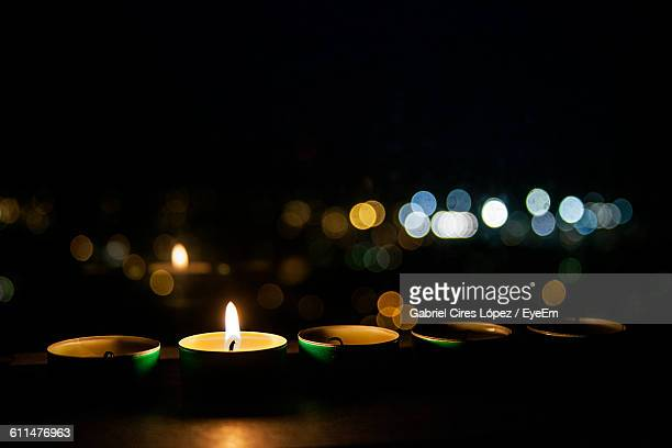 close-up of illuminated diya on table - oil lamp stock pictures, royalty-free photos & images