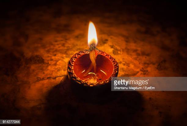 close-up of illuminated diya on table - diwali stock pictures, royalty-free photos & images