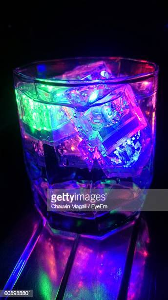 close-up of illuminated drink served on table - chauvin stock pictures, royalty-free photos & images
