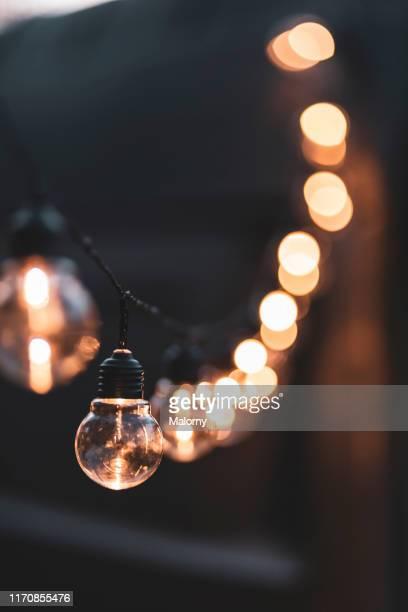close-up of illuminated fairy lights. - ストリングライト ストックフォトと画像