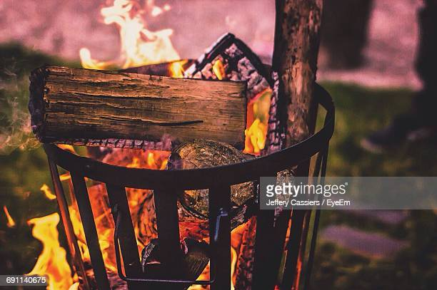 Close-Up Of Illuminated Fire Pit During Sunset