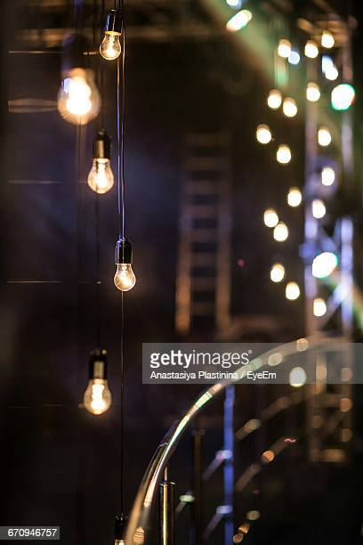 Close-Up Of Illuminated Hanging Lights In Row