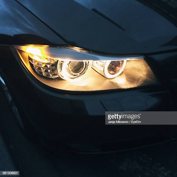 Close-Up Of Illuminated Headlight