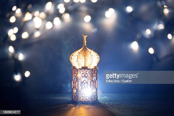 close-up of illuminated lamp against lighting equipment - ramadan decoration stock pictures, royalty-free photos & images