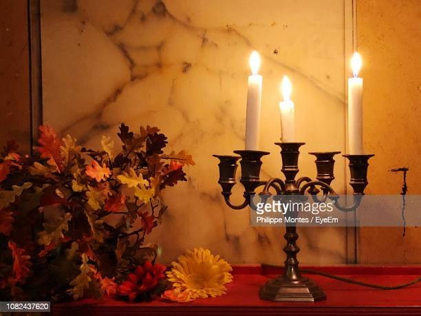 close-up of illuminated lamp at home - candlestick holder stock pictures, royalty-free photos & images